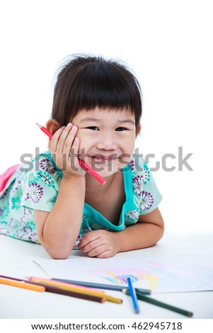 Pretty asian girl lie on the floor looking at camera and smiling. Concepts of creativity and education, strengthen the imagination of child. Studio shot. Isolated on white background.