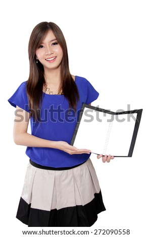 Pretty Asian girl showing a content of notebook, isolated on white background - stock photo