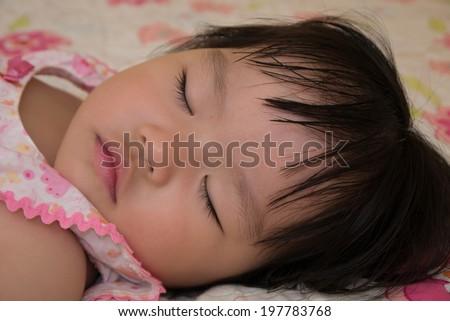 Pretty Asian Girl Toddler sleeping - stock photo