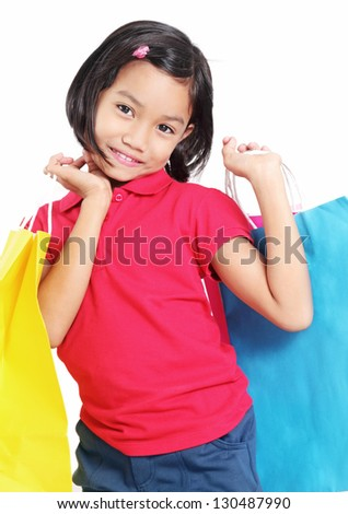 Pretty asian girl with colorful shopping bags. - stock photo