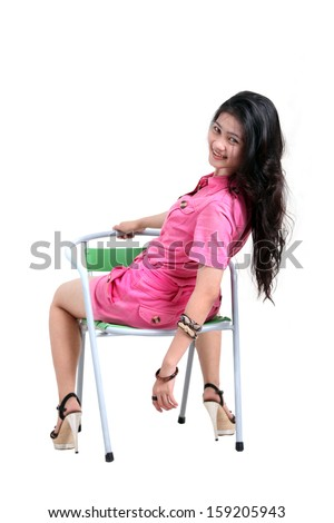 pretty asian siting on chair white background