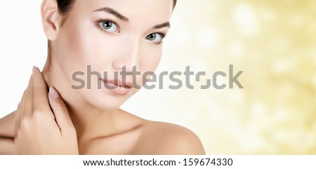 Pretty asian woman against an abstract background with circles and copyspace