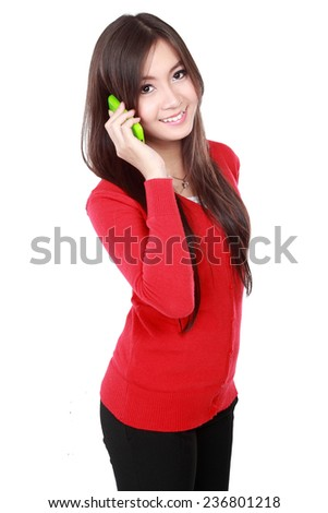 Pretty Asian Woman call her friend by cellphone - stock photo