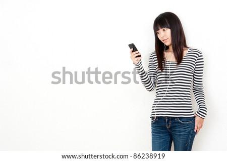 pretty asian woman listening music - stock photo