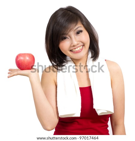 pretty Asian woman showing an apple on her hand