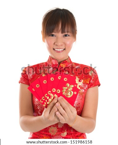 Pretty Asian woman with Chinese traditional dress cheongsam or qipao holding ang pow or red packet monetary gift. Chinese new year concept, female model isolated on white background.