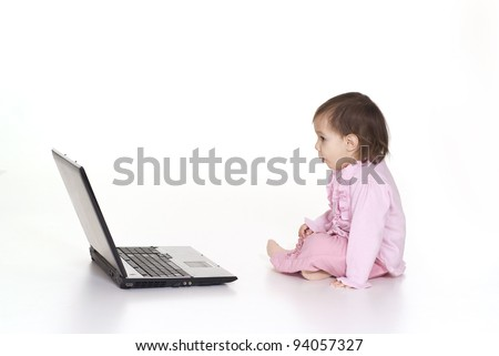 pretty baby and laptop on a white