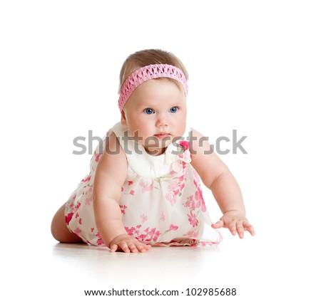 pretty baby girl crawling on floor - stock photo