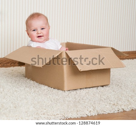 pretty baby girl inside a box
