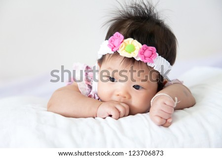 Pretty baby girl on white background