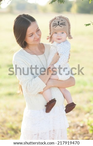 Pretty baby in arms - stock photo