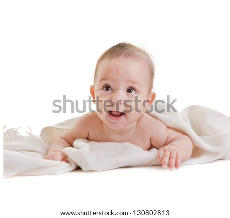 pretty baby plays on a white, isolated