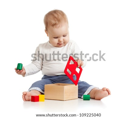 pretty baby with colorful educational toy - stock photo