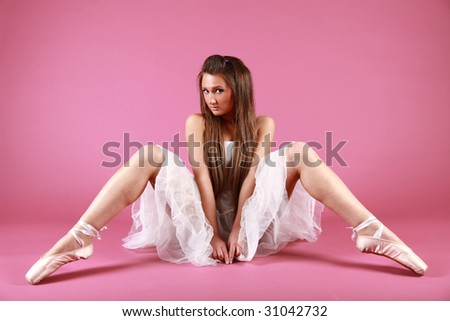 Pretty ballet dancer on pink - stock photo