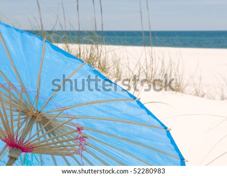 Pretty beach parasol at seashore