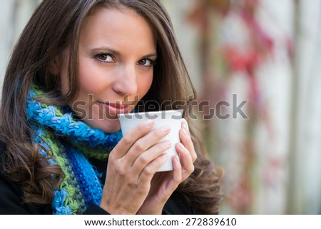 Pretty beautiful woman drinking coffee - stock photo