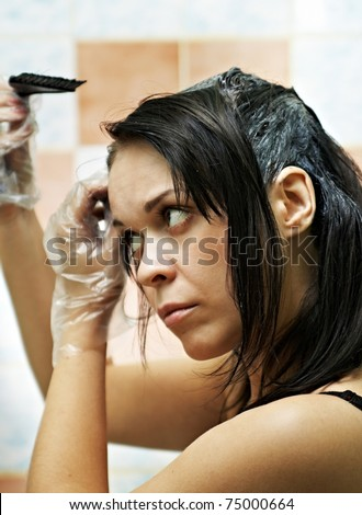 pretty beautiful young woman dyeing hairs