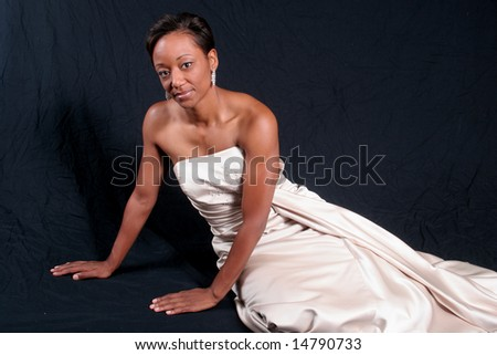 Pretty black African American woman reclining - stock photo