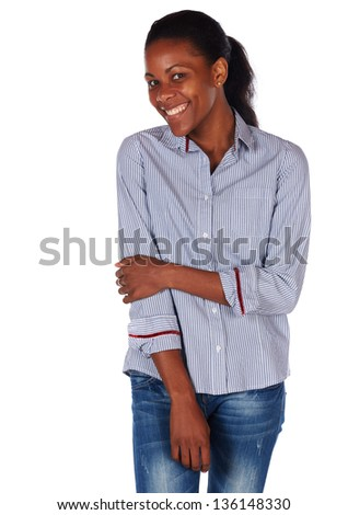 Pretty black african young adult businesswoman casually dressed in a blue pinstripe office shirt with her hair slicked back into a ponytail and isolated on a white background