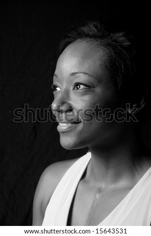 Pretty black woman in black and white - stock photo