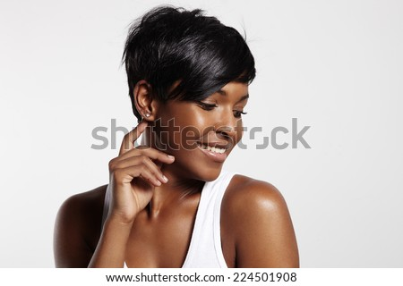 pretty black woman is smiling - stock photo