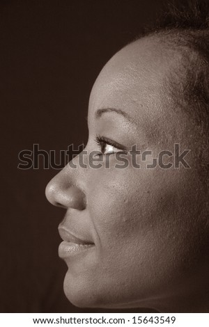 Pretty black woman looking left - stock photo