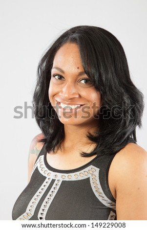 Pretty black woman smiling at the camera - stock photo