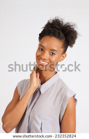Pretty black woman standing and smiling at the camera