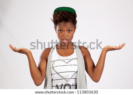 Pretty black woman with a big smile and holding her hands out like she is saying that she does not know - stock photo