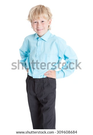Pretty blond boy wearing blue shirt looking at camera, isolated on white background - stock photo