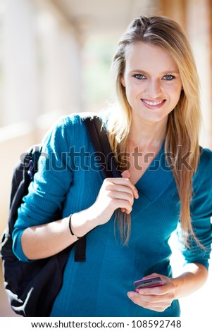 pretty blond female college student portrait - stock photo