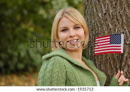 Pretty blond girl holding American flag.