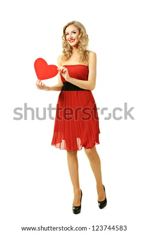 Pretty blond girl holding heart shape  - valentine day concept