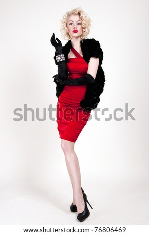 Pretty blond girl model like Marilyn Monroe in red dress with red lips on white background - stock photo