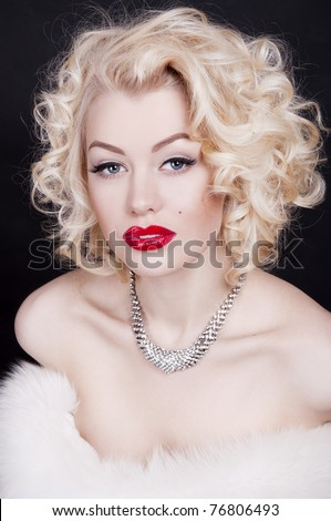 Pretty blond girl model like Marilyn Monroe with red lips on black background - stock photo