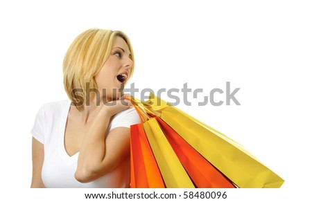Pretty blond girl with her colorful shopping bags