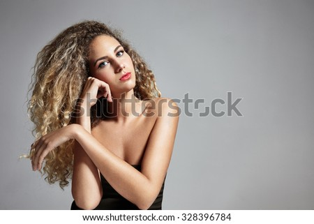 pretty blond oman with big curly hair - stock photo