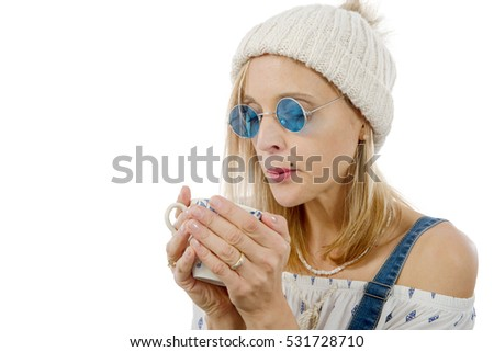 pretty blond woman drink a cup of tea