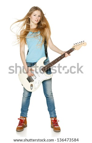 Pretty blond woman playing the guitar in full length over white background - stock photo
