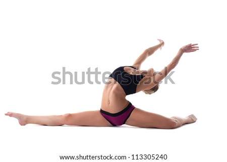 pretty blond woman show perfect split isolated - stock photo