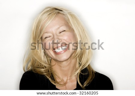 Pretty Blond woman smiling - stock photo
