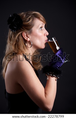 Pretty blond woman taking a sip from her glass