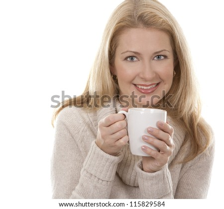pretty blond woman wearing beige sweather drinking coffee - stock photo