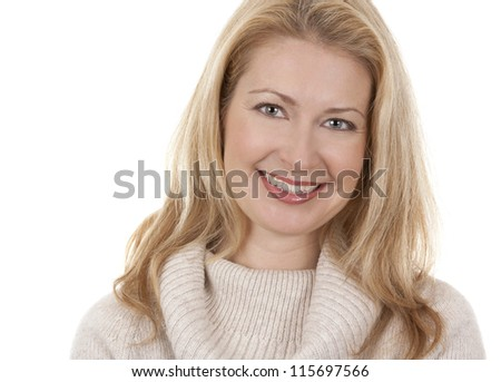 pretty blond woman wearing beige sweather on white background