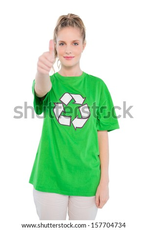 Pretty blonde activist wearing recycling tshirt giving thumb up on white background - stock photo