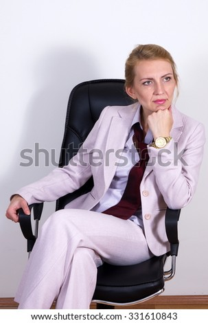 pretty blonde business woman on chair