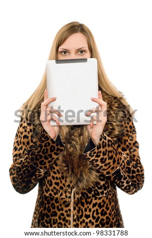 Pretty blonde covers face with the tablet pc - stock photo