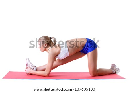 Pretty blonde doing aerobics exercises on mat