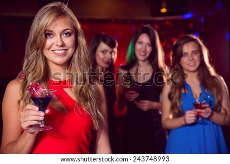 Pretty blonde drinking a cocktail at the nightclub