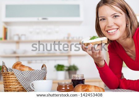 Pretty blonde enjoys a hearty breakfast at home - stock photo